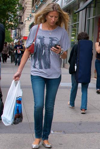 Woman Walking on city street.